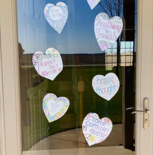 Hearts on windows with hand-drawn sayings: be your best self, stay strong, count your blessings